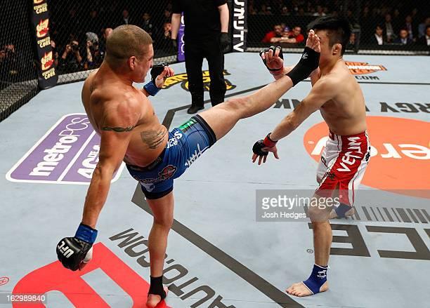 Diego Sanchez kicks Takanori Gomi in their lightweight fight during the UFC on FUEL TV event at Saitama Super Arena on March 3, 2013 in Saitama,...