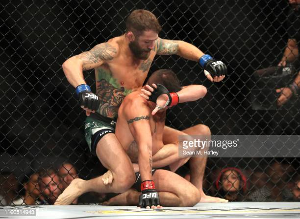 Diego Sanchez of the United States botom is punched by Michael Chiesa of the United States during their UFC 239 Welterweight bout at TMobile Arena on...