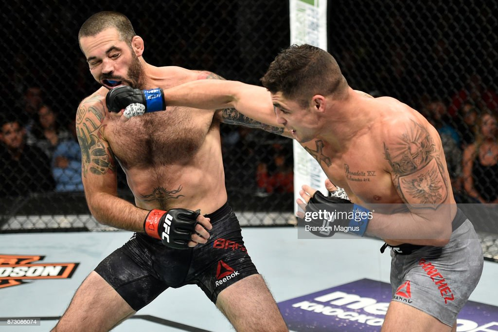 Diego Sanchez punches Matt Brown in their welterweight bout during the UFC Fight Night event inside the Ted Constant Convention Center on November 11, 2017 in Norfolk, Virginia.