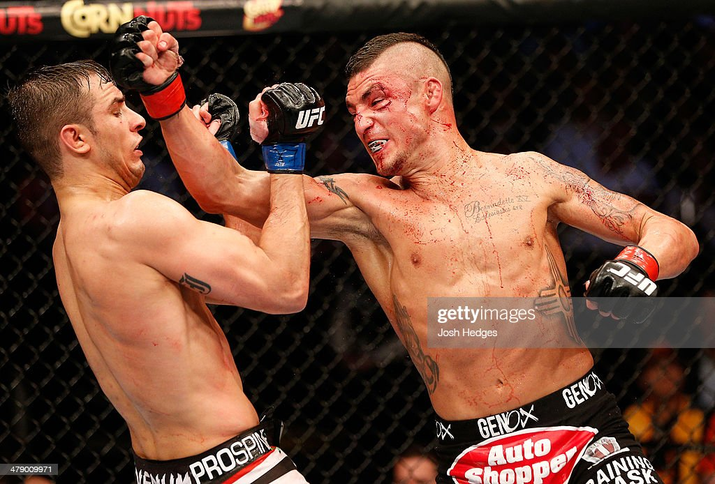 Diego Sanchez punches Myles Jury in their lightweight bout at UFC 171 inside American Airlines Center on March 15, 2014 in Dallas, Texas.