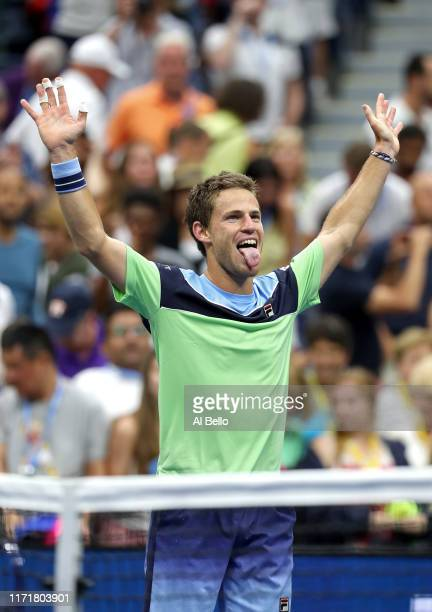 Diego Schwartzman of Argentina celebrates after winning his Men's Singles fourth round match against Alexander Zverev of Germany on day eight of the...