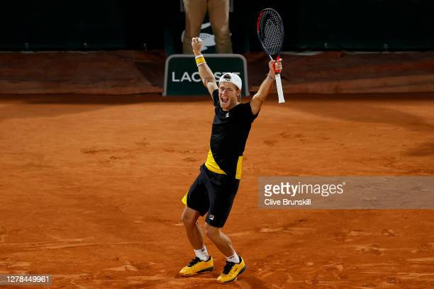 Diego Schwartzman of Argentina celebrates after winning match point during his Men's Singles fourth round match against Lorenzo Sonego of Italy on...
