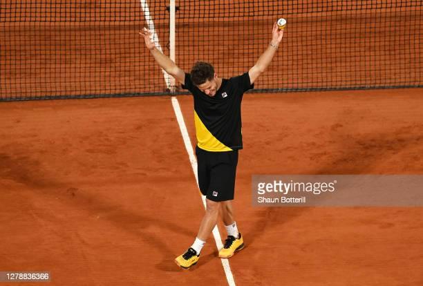 Diego Schwartzman of Argentina celebrates after winning match point during his Men's Singles quarterfinals match against Dominic Thiem of Austria on...
