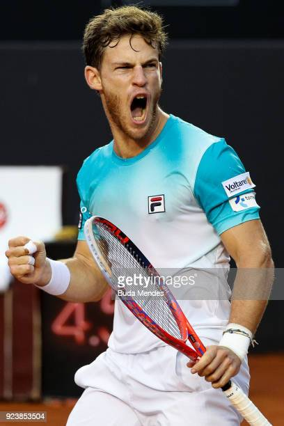Diego Schwartzman of Argentina celebrates after winning the first set against Nicolas Jarry of Chile during the singles semi final of the ATP Rio...
