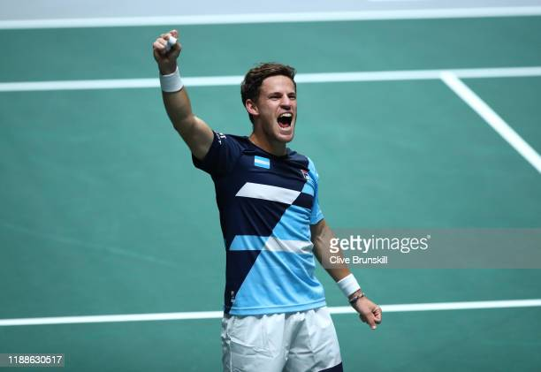 Diego Schwartzman of Argentina celebrates victory during Day 2 of the 2019 Davis Cup at La Caja Magica on November 19 2019 in Madrid Spain