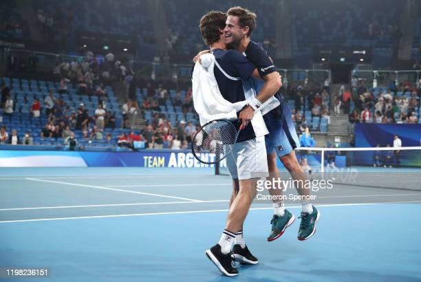 Diego Schwartzman of Argentina celebrates with Guido Pella of Argentina after winning his Group E singles match against Borna Coric of Croatia during...