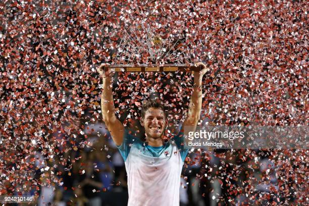 Diego Schwartzman of Argentina celebrates with the trophy after defeating Fernando Verdasco of Spain at the singles final of the ATP Rio Open 2018 at...