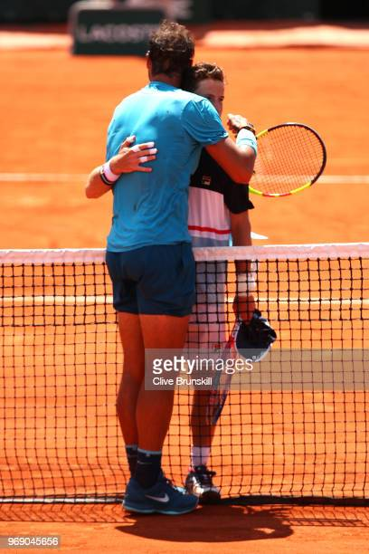 Diego Schwartzman of Argentina congratulates Rafael Nadal of Spain on victory following their mens singles quarter finals match during day twelve of...