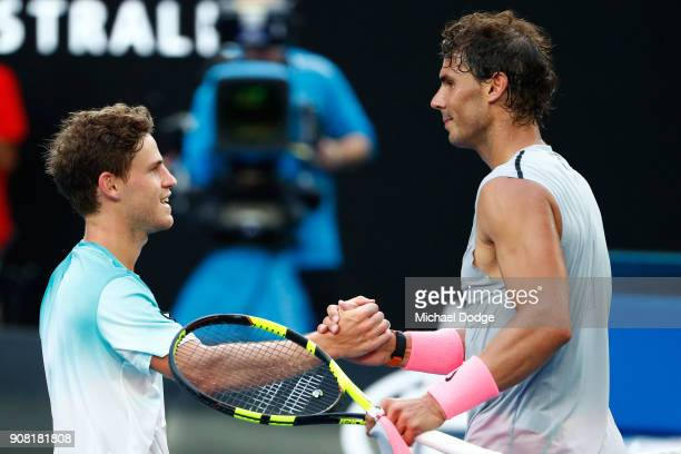 Diego Schwartzman of Argentina congratulates Rafael Nadal of Spain after Nadal won their fourth round match against on day seven of the 2018...