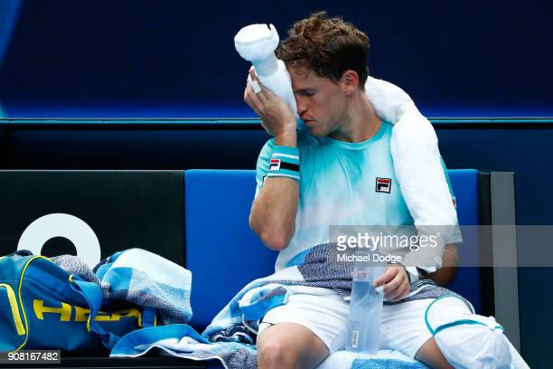 Diego Schwartzman of Argentina cools down between games in his fourth round match against Rafael Nadal of Spain on day seven of the 2018 Australian...