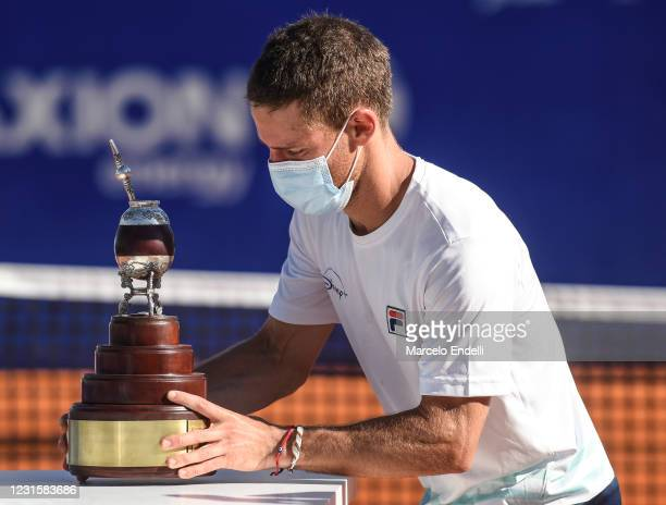 Diego Schwartzman of Argentina holds the champions trophy after winning a Men's Singles Final match against Francisco Cerundolo of Argentina as part...