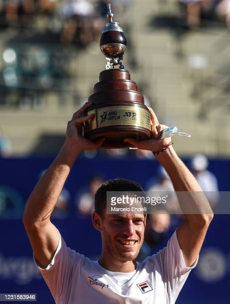 Diego Schwartzman of Argentina lifts the champions trophy after winning a Men's Singles Final match against Francisco Cerundolo of Argentina as part...