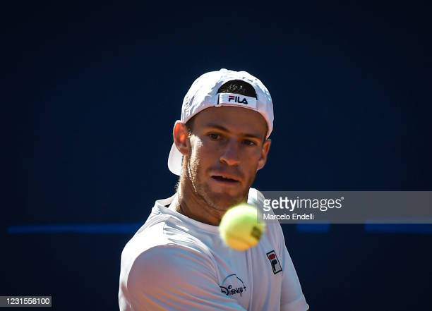 Diego Schwartzman of Argentina looks at the ball during a match against Miomir Kecmanovic of Serbia with a part of second semifinal during day 6 of...