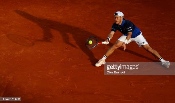 Diego Schwartzman of Argentina plays a forehand against Kyle Edmund of Great Britain in their first round match during day two of the Rolex...