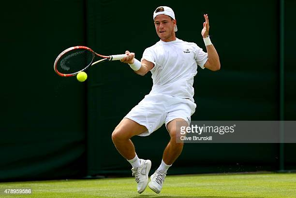 Diego Schwartzman of Argentina plays a forehand in his match against Nick Kyrgios of Australia during day one of the Wimbledon Lawn Tennis...