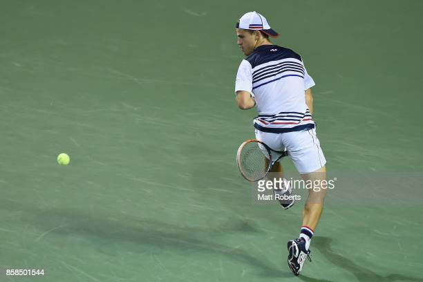 Diego Schwartzman of Argentina plays a shot between the legs in his semi final match against David Goffin of Belgium during day six of the Rakuten...