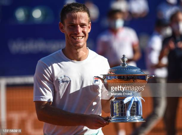 Diego Schwartzman of Argentina poses with the Centenary Cup trophy after winning a Men's Singles Final match against Francisco Cerundolo of Argentina...