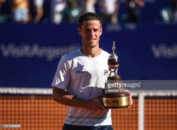 Diego Schwartzman of Argentina poses with the champions trophy after winning a Men's Singles Final match against Francisco Cerundolo of Argentina as...