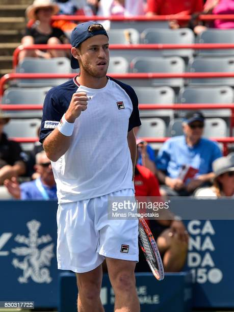 Diego Schwartzman of Argentina reacts after scoring a point against Robin Haase of Netherlands during day eight of the Rogers Cup presented by...
