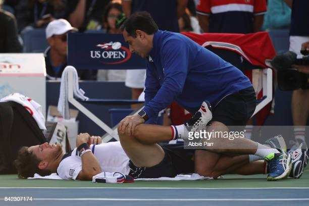 Diego Schwartzman of Argentina receives medical treatment during his men's singles fourth round match against Lucas Pouille of France on Day Seven of...