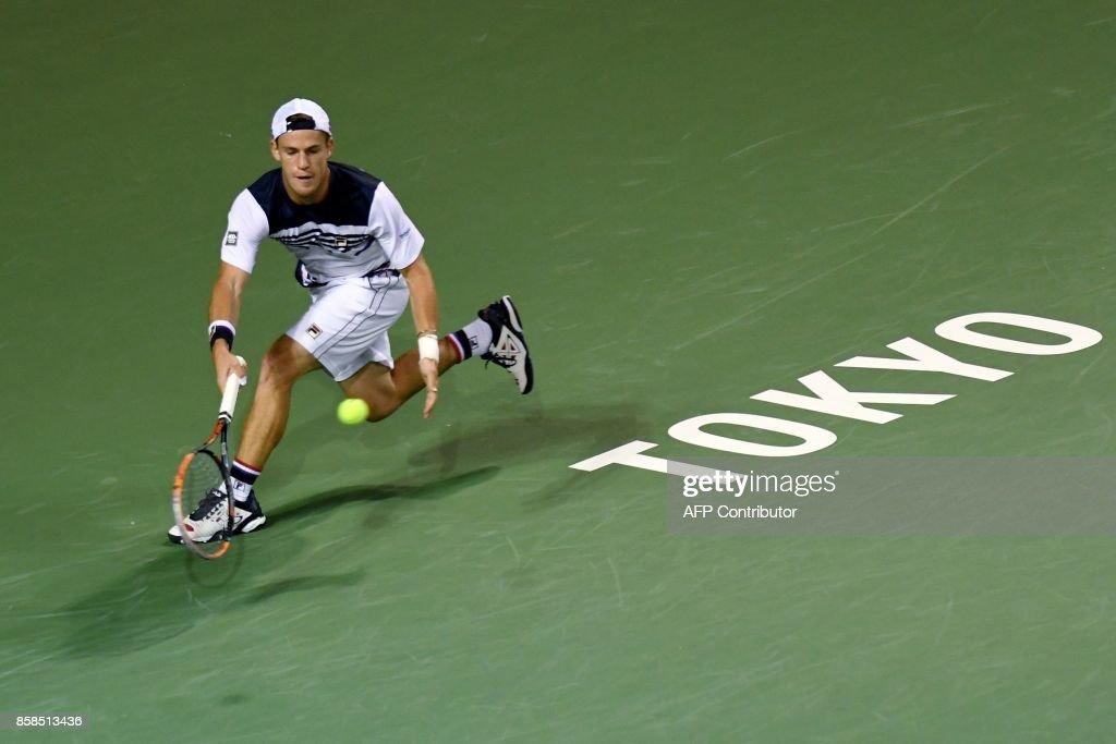 Diego Schwartzman of Argentina returns a shot against David Goffin of Belgium during their men's singles semi-final match of the Japan Open tennis tournament in Tokyo on October 7, 2017. / AFP PHOTO / Toru YAMANAKA