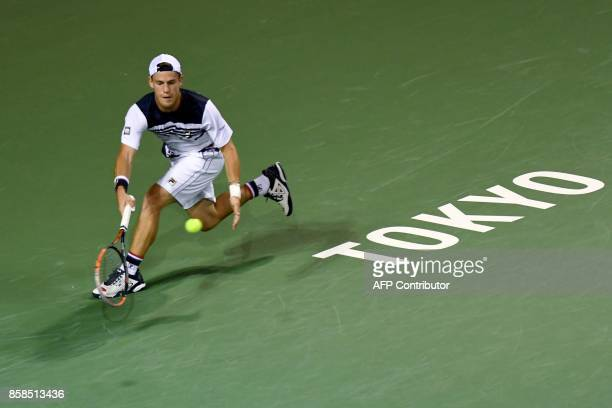 Diego Schwartzman of Argentina returns a shot against David Goffin of Belgium during their men's singles semifinal match of the Japan Open tennis...