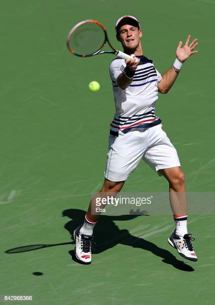 Diego Schwartzman of Argentina returns a shot against Pablo Carreno Busta of Spain during his Men's Singles Quarterfinal match on Day Nine of the...