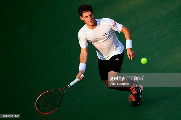 Diego Schwartzman of Argentina returns a shot against Rafael Nadal of Spain during their Men's Singles Second Round match on Day Three of the 2015 US...