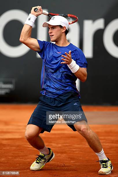 Diego Schwartzman of Argentina returns a shot to Dominic Thiem of Austria during the Rio Open at Jockey Club Brasileiro on February 17 2016 in Rio de...