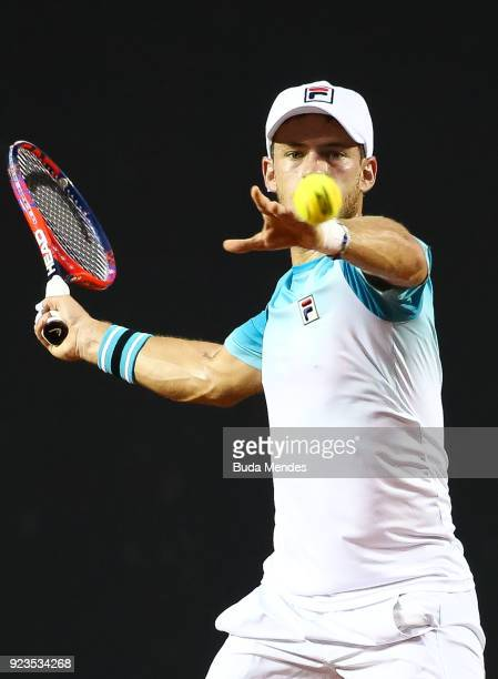 Diego Schwartzman of Argentina returns a shot to Gael Monfils of France during the quarter finals of the ATP Rio Open 2018 at Jockey Club Brasileiro...