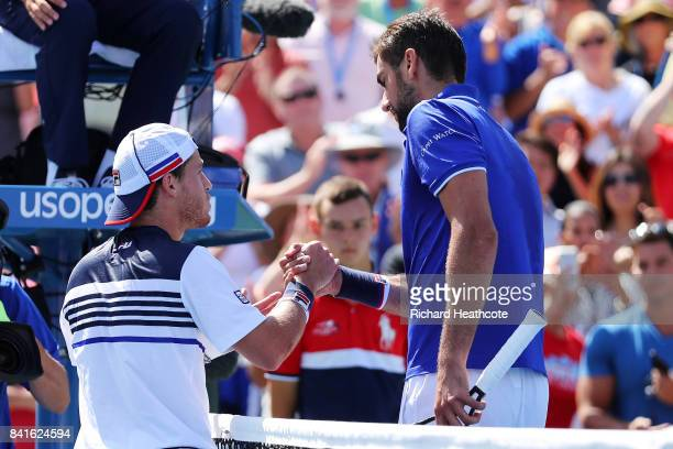 Diego Schwartzman of Argentina shakes hands with Marin Cilic of Croatia after his third round victory on Day Five of the 2017 US Open at the USTA...