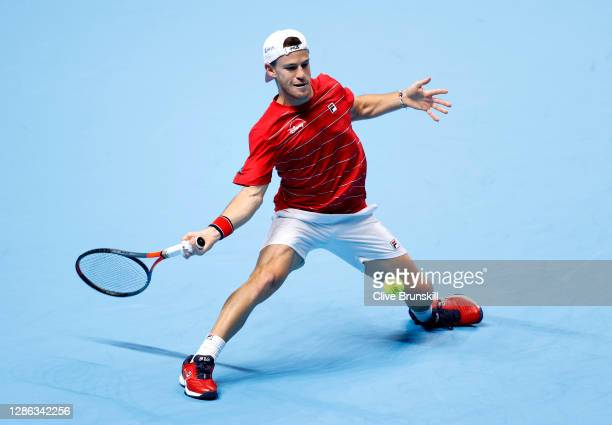 Diego Schwartzman of Argentina stretches for a forehand shot during his singles match against Alexander Zverev of Germany on Day 4 of the Nitto ATP...
