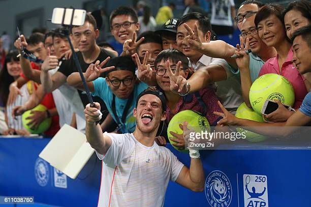 Diego Schwartzman of Argentina takes selfie with fans after winning the match against Paolo Lorenzi of Italy during Day 3 of 2016 ATP Chengdu Open at...