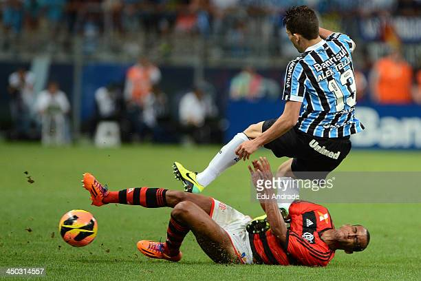 Diego Silva of Flamengo fights for the ball with Alex Telles of Gremio during the match between Gremio and Flamengo for the Brazilian Series A 2013...