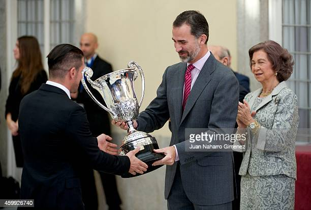Diego Simeone and King Felipe VI of Spain attend National Sport Awards 2013 at Royal Palace of El Pardo on December 4 2014 in Madrid Spain
