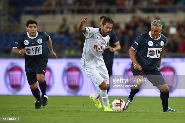 Diego Simeone and Roberto Baggio during the Interreligious Match For Peace at Olimpico Stadium on September 1 2014 in Rome Italy