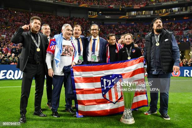 Diego Simeone Coach of Atletico Madrid and German Burgos assistant coach of Atletico Madrid celebrate victory with coaching staff after the Europa...