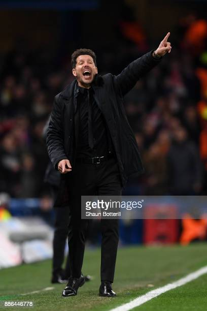 Diego Simeone Coach of Atletico Madrid gives his team instructions during the UEFA Champions League group C match between Chelsea FC and Atletico...