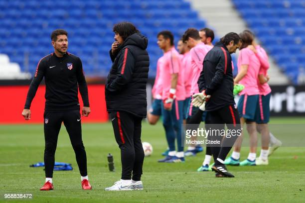 Diego Simeone Coach of Atletico Madrid speaks to Assisant Coach German Burgos during a Club Atletico de Madrid training session ahead of the the UEFA...