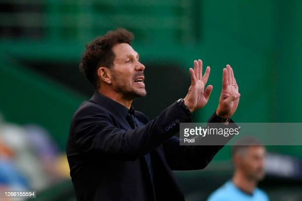 Diego Simeone, Head Coach of Atletico de Madrid gives his team instructions during the UEFA Champions League Quarter Final match between RB Leipzig...