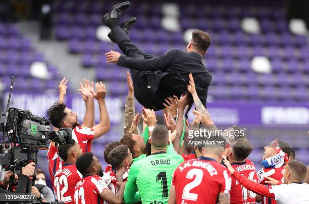 Diego Simeone, Head Coach of Atletico de Madrid is thrown in the air by his players as they celebrate winning the La Liga Santander title after...