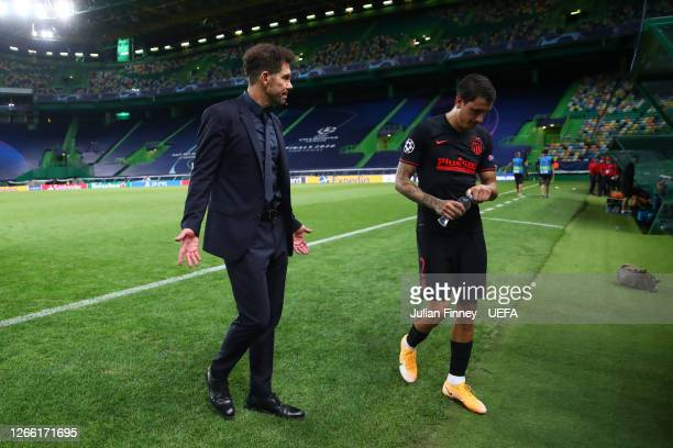 Diego Simeone, Head Coach of Atletico de Madrid speaks with Jose Gimenez of Atletico de Madrid following the UEFA Champions League Quarter Final...