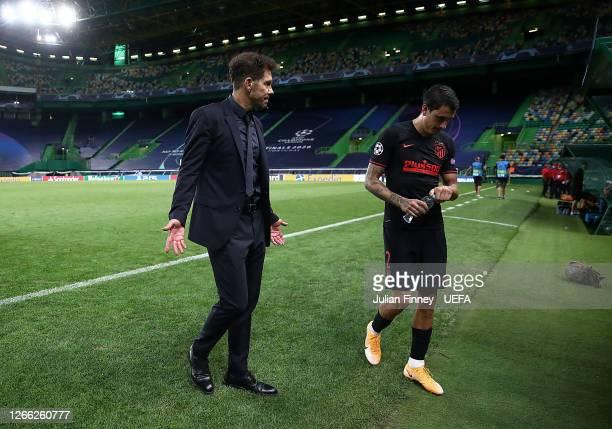 Diego Simeone, Head Coach of Atletico de Madrid walks off dejected with Jose Gimenez of Atletico de Madrid following the UEFA Champions League...