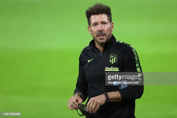 Diego Simeone, head coach of Atletico looks on during a final training session ahead of the UEFA Champions League Group A stage match between...