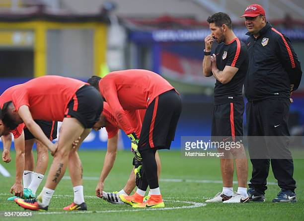Diego Simeone head coach of Atletico Madrid and his assistant coach German Burgos look on during an Atletico de Madrid training session on the eve of...