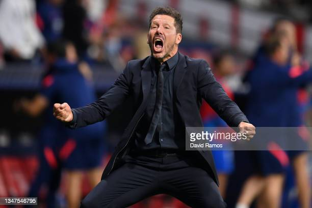 Diego Simeone, Head Coach of Atletico Madrid celebrates their side's second goal scored by Antoine Griezmann of Atletico Madrid during the UEFA...