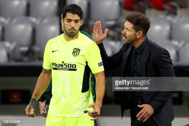 Diego Simeone, head coach of Madrid reacts to his player Luis Suarez during the UEFA Champions League Group A stage match between FC Bayern Muenchen...