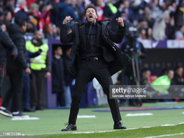 Diego Simeone Manager of Atletico Madrid celebrates after a VAR review leads to his team's first goal being awarded during the La Liga match between...