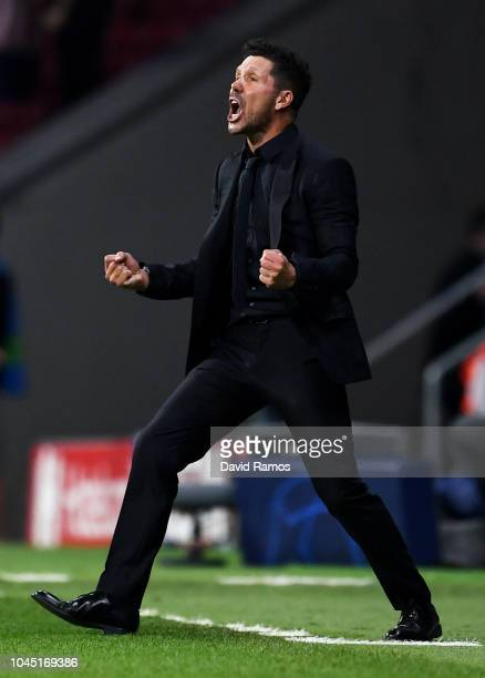 Diego Simeone Manager of Atletico Madrid celebrates after Koke of Atletico Madrid scored their third goal during the Group A match of the UEFA...