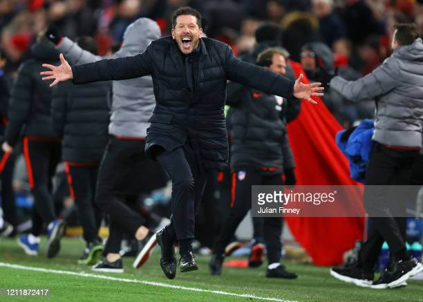 Diego Simeone Manager of Atletico Madrid celebrates his sides second goal during the UEFA Champions League round of 16 second leg match between...